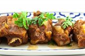 stock photo of baby back ribs  - close up Pork rib roast with a sweet sauce on a white plate