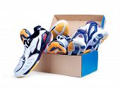 stock photo of shoe-box  - Sneakers In Shoe Cardboard Box Isolated On White Background - JPG