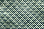 picture of quilt  - grained texture of green quilted fabric with an abstract pattern from crosses - JPG