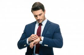 pic of retarded  - Handsome businessman looking on his wrist watch isolated on a white background - JPG