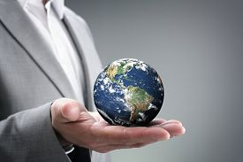 pic of nature conservation  - Businessman holding the world in the palm of hands concept for global business, communications, politics or environmental conservation  Earth image courtesy of Nasa at http://visibleearth.nasa.gov   - JPG