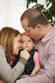 picture of nuclear family  - Baby girl sleeping in father - JPG
