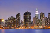 picture of gleaning  - Cityscape of Midtown Manhattan across the Hudson River at night - JPG