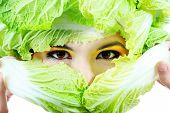 Shot of a beautiful young woman with vegetables headwear. Food concept, healthcare.