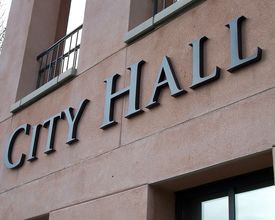 image of city hall  - Sign on the side of the city hall building - JPG