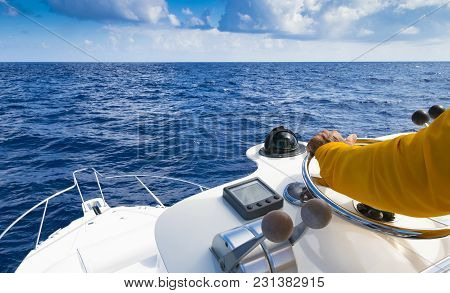 poster of Hand Of Captain On Steering Wheel Of Motor Boat In The Blue Ocean During The Fishery Day. Success Fi