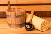 Sauna Wooden Bucket, Ladle, Essential Oils And Towel poster