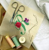 foto of embalming  - Sewing needle with bobbins of cotton thread and needlework - JPG