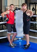 Boxing ring with two men boxer. Man engage in martial arts. Sportsman do fitness. Boxers wear helmet poster