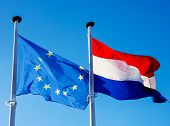 closeup of a flag of the European Union and a flag of Luxembourg hanging in its respective poles, wa poster