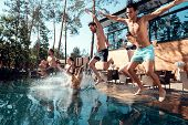 Company Of Happy Young People Jumping In Pools Forming Splashes. Swimming Pool Party Concept. Holida poster