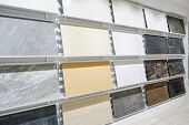 Colorful Samples Of A Stone Tile In Store. Marble And Granite Flooring A Most Popular Choice For Mod poster