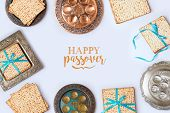Jewish Holiday Passover Frame Composition With Matzo And Seder Plate On White Background. View From  poster