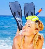 stock photo of swimsuit model  - Beautiful female closeup portrait on the beach wearing snorkeling equipment water sport healthy lifestyle concept - JPG