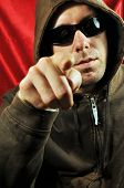 foto of gangsta  - Gangsta like man with sunglasses pointing to camera - JPG