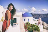 Europe Greece Santorini luxury travel vacation woman on famous santorini Oia island travel european  poster