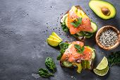 Open Sandwich Or Toast. Grain Bread With Salmon, White Cheese, Avocado, Cucumber And Spinach. Health poster