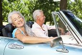 image of mature men  - Senior couple in sports car - JPG
