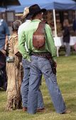 foto of sixgun  - Two men dressed in old west period costume complete with hats guns and boots and a woman in a buckskin dress - JPG