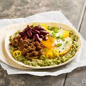 Breakfast Taco With Guacamole, Sunny Side Up Egg, Soy Meat And Kidney Beans poster