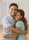 image of married couple  - Hispanic couple hugging - JPG