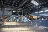 Excavator Stacks Trash In Big Pile At Sorting Modern Waste Recycling Processing Plant. Separate And poster