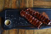 Delicious Bbq Ribs, Cole Slaw And A Tangy Bbq Sauce. Ribs In A Beer Bar Or Cafe, Restaurant. Delicio poster