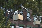Drone Quadcopter Delivering Package Flying At The Street. Modern Service And Delivery. 3d Rendering. poster