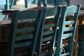 Empty Taverna Tables And Seating At A Restaurant In A Square On The Island Of Folegandros. Close Up  poster