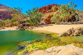 Scenic Landscape Of Ormiston Gorge Water Hole With Ghost Gum In West Macdonnell Ranges, Northern Ter poster