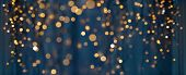 holiday illumination and decoration concept - christmas garland bokeh lights over dark blue backgrou poster