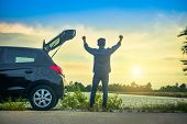 Man Standing At Car Parked On Road,boy Holding Hand Success At Car On Street Sky Sunlight Background poster