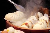 Cooking of traditional chinese fast food steamed buns (mantou) on street market poster