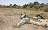 image of prone  - Shooter laying on the ground taking a shot at a target at 100 yards - JPG