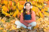 Schoolgirl Study. Study Every Day. Girl Read Book Autumn Day. Self Education Concept. Child Enjoy Re poster