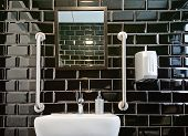 Modern Design Of Toilet Closet Room With Black Glossy Tiles. Gloss Black Tile For Contemporary Decor poster