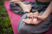 Yoga Man Meditating At Sunset. Male Model Of Meditation In Serene Harmony poster