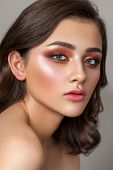 Beautiful Young Model With A Very Beautiful Colorful Smoky Eyes, Bright Blue Eyes And Natural Hairdo poster