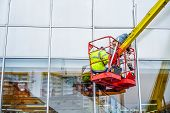 High-altitude Installation Works.  Professional Installation Work On A Telescopic Boom Lift Platform poster