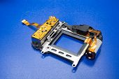 Camera shutter part. Electronic shutter device component of electronic photo camera. poster