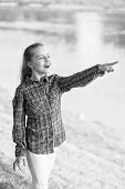 Always Summer. Small Girl Pointing Finger At River On Summer Landscape. Adorable Child With Long Blo poster