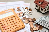 House Model With Calculator, Documents, Keys And Money On Table, Closeup. Real Estate Agent Service poster