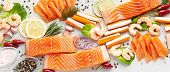 Banner Of Fresh Seafood On A Table With Spices, Vegetables And Olive Oil: Fresh And Smoked Salmon, S poster