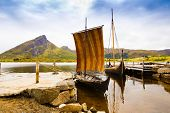 Landscape With Viking Boats At Village Small Harbor, Mountains And Fjord In Lofoten Islands, Norway. poster