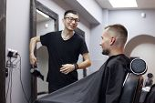 Kazakh Young Hairdresser Works In A Hairdresser, Guy Sits In A Barbershop And Makes A Short Haircut poster