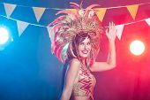 Carnival, Dancer And Holiday Concept - Portrait Of A Sexy Female In A Colorful Sumptuous Carnival Fe poster