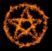 stock photo of pentacle  - orange flame pentagram isolated on black background - JPG