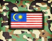 stock photo of ami  - Amy camouflage uniform with flag on it Malaysia - JPG
