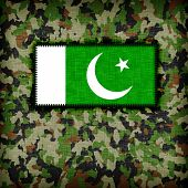 stock photo of ami  - Amy camouflage uniform with flag on it Pakistan - JPG