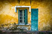 picture of grating  - Outside view of deserted house with details in Vietnam - JPG
